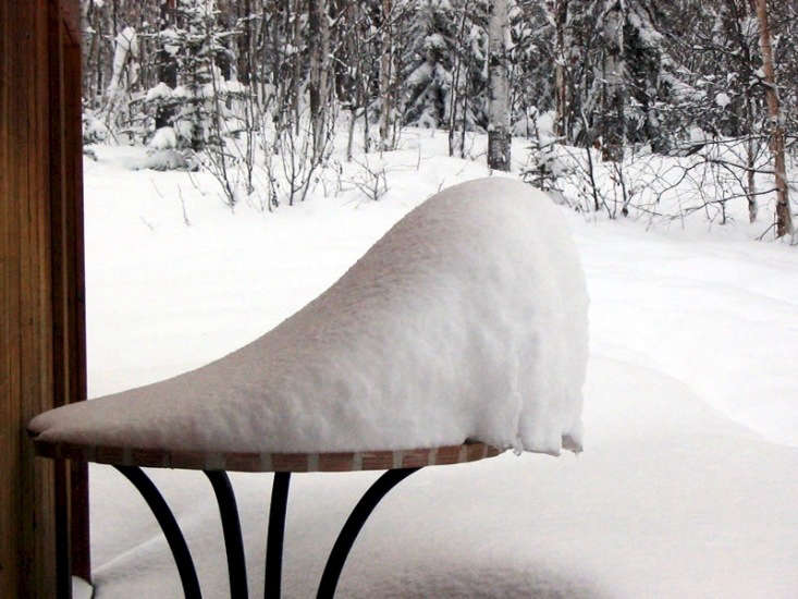 Some furniture is made to withstand weather (case in point: this bistro table, no worse for the wear after a January snowstorm). Other furniture? Could use help. Photograph by Doug Noon via Flickr.