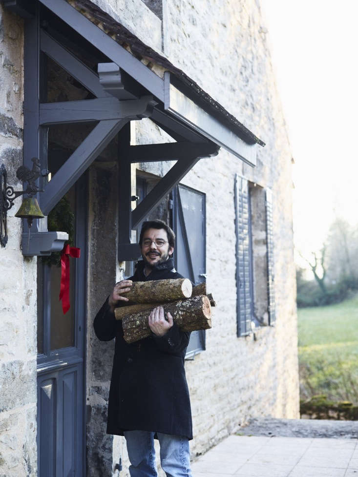 One red bow is all it takes to make visitors feel welcome at an entryway. Laurent Franchini of The Cook&#8\2\17;s Atelier delivers an armload of firewood at home in Burgundy.