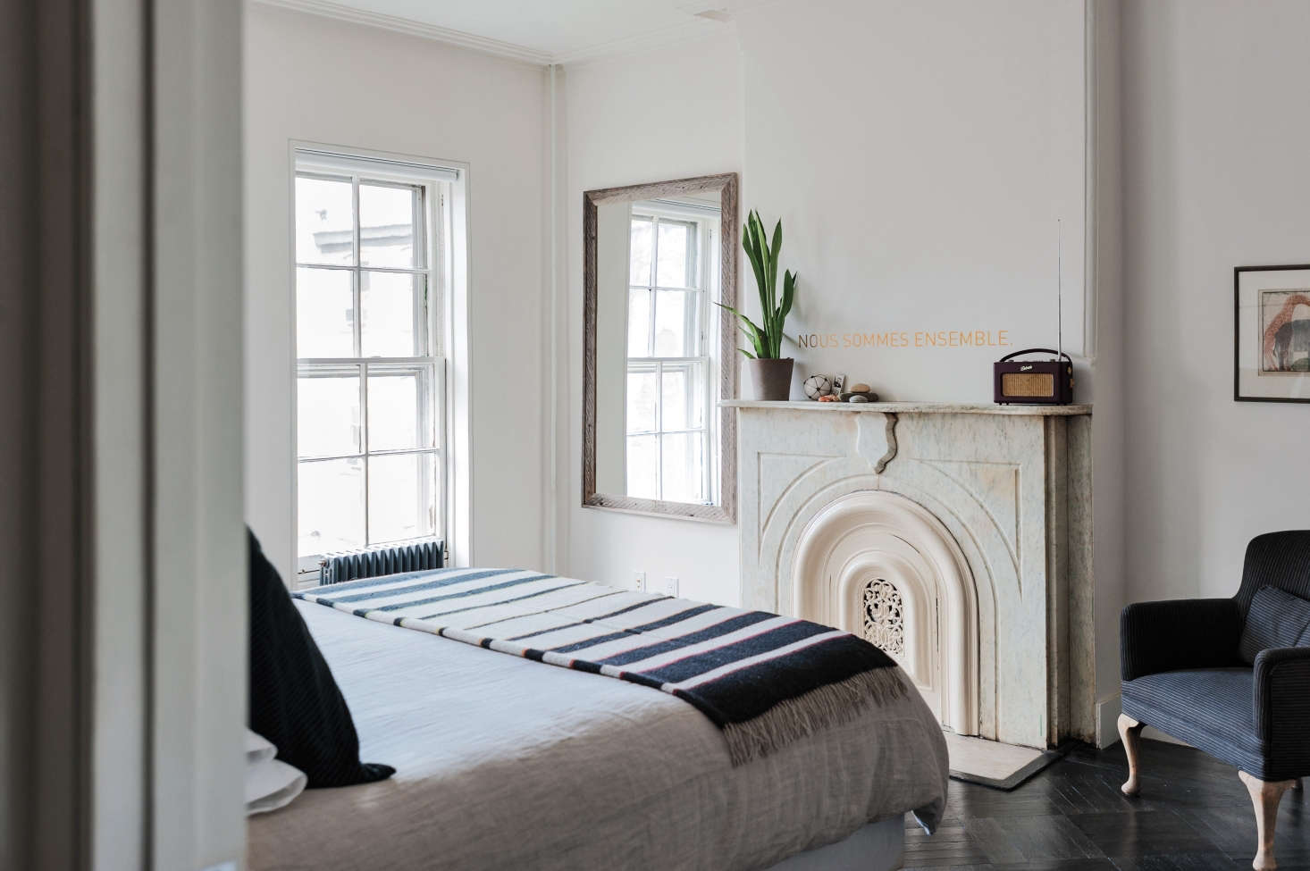 A non-functioning fireplace in a small bedroom by designer Elizabeth Roberts. Photograph by Matthew Williamsfrom Remodelista: A Manual for the Considered Home.