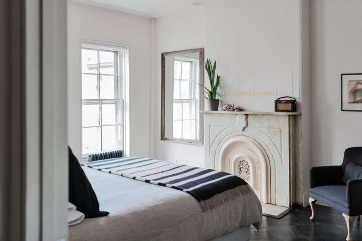 A non-functioning fireplace in a small bedroom by designer Elizabeth Roberts. Photograph by Matthew Williams from Remodelista: A Manual for the Considered Home.