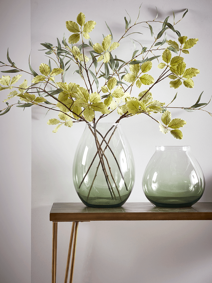 A Green Glass Vase is available in two sizes, for £45 or £55, depending on size, from Cox & Cox.