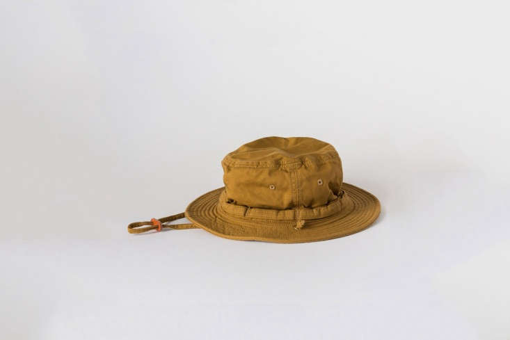 The Japanese Works and Labo Work Hat in sand-colored cotton has a wide brim and adjustable neck strap; $loading=