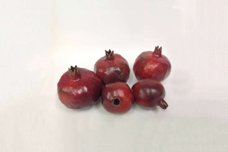 Penkridge Ceramics in Birmingham, England has been making porcelain fruit and vegetables since \1984. You can source the range of produce from John Derian in New York City and Sweet Bella online as well as directly from Penkridge Ceramics in the UK. Shown here are the red pomegranates.