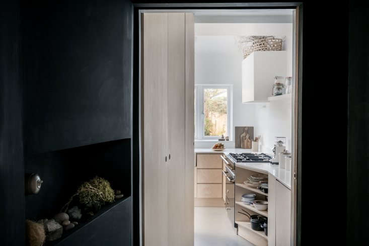A big window above the kitchen sink connects indoors to out, with a view of the back garden.