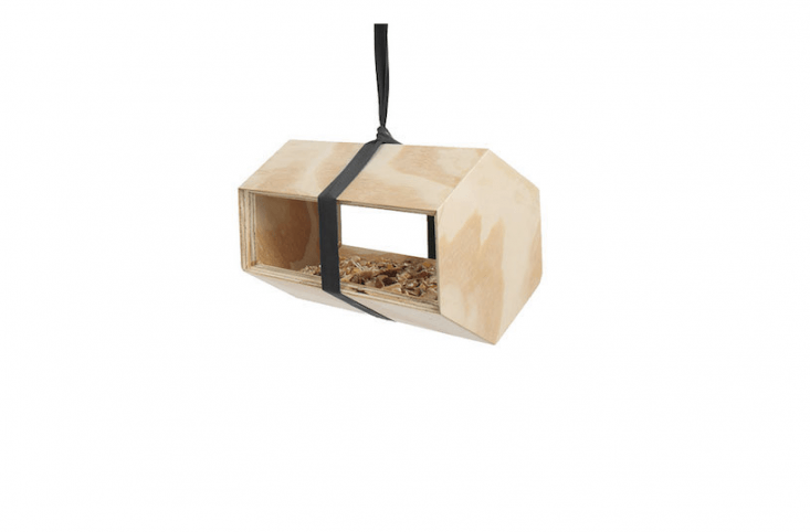 ANeighbirds feeder and birdhouse designed by Andreu Carulla and made of untreated pine has a polyester hanging strap; \$38 from Luminaire.