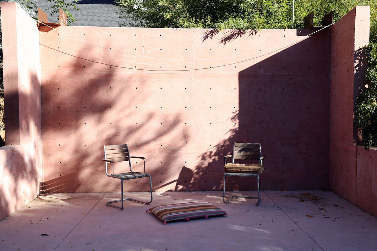 To the side of the garden, near its entrance, is a concrete frame that&#8