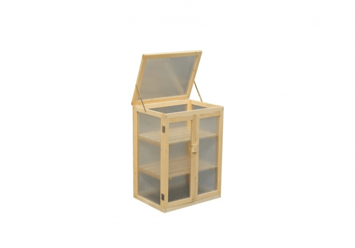 Made of fir, aMini Greenhouse with two shelves and a ventilated lid has UV-proofpolycarbonate panels;£88.99 from Wayfair.