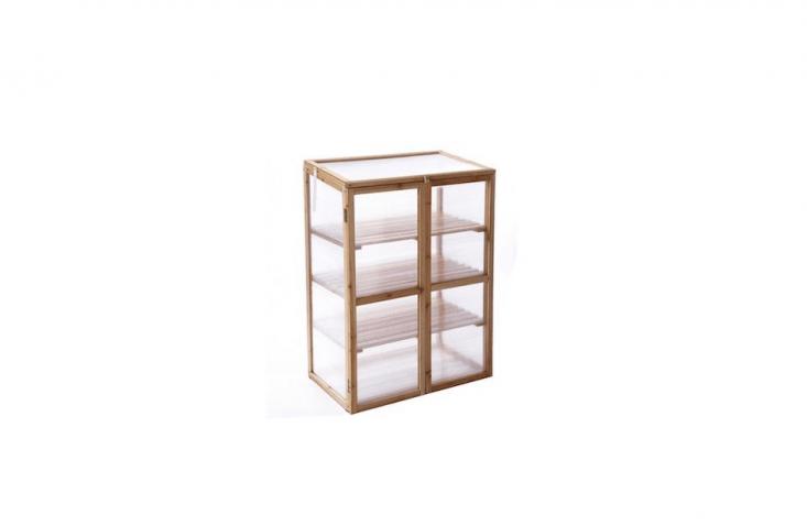 A decay-resistant solid wood Mini Greenhouse haspolycarbonate window panels; \$\2\19.99 via Amazon.