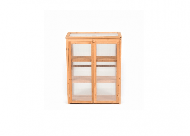 A 4\2-inch-highTerra Lean-To Mini Greenhouse made of fir has a polycarbonate back panel and is £69.99 from Greenfingers.
