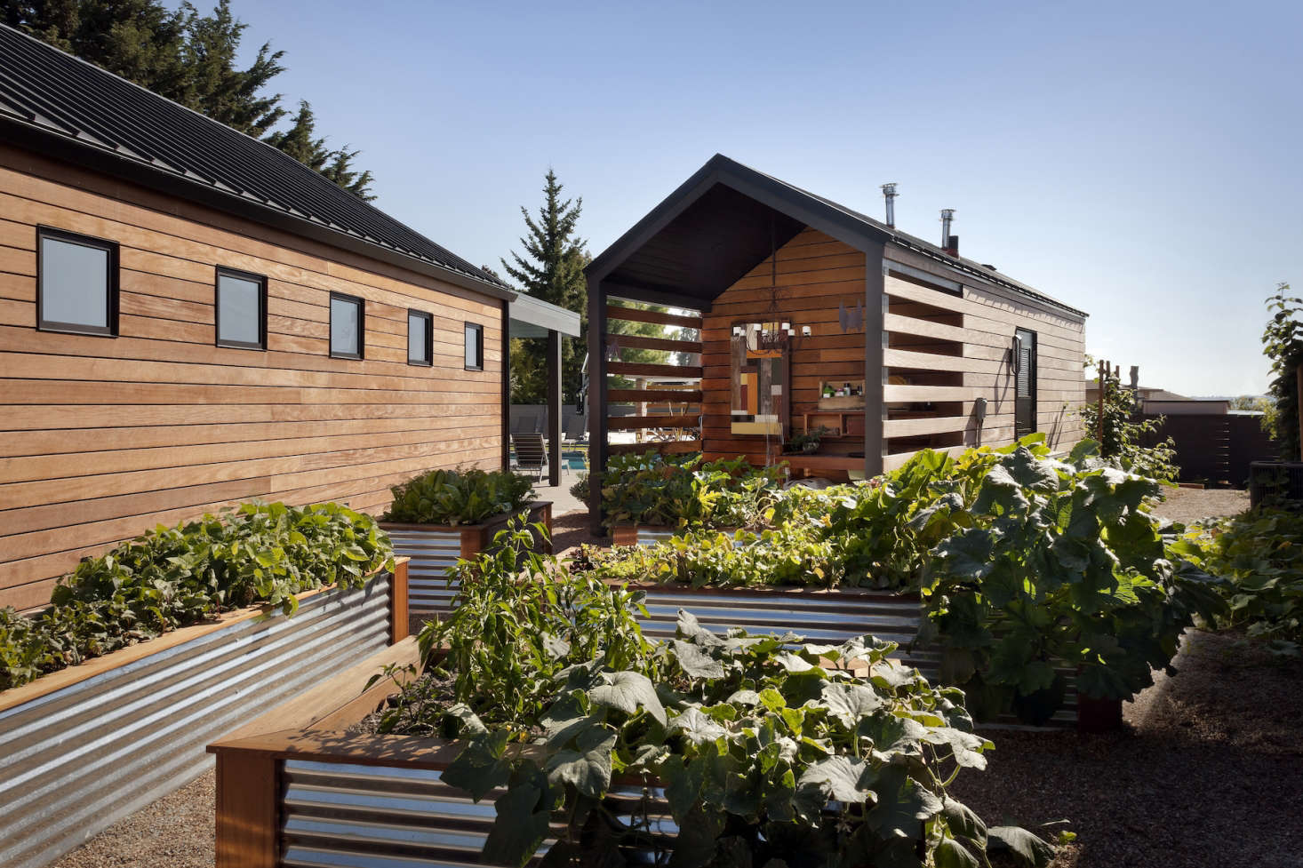 The homeowners wanted a vegetable garden made of corrugated steel beds, so the design team framed them in ipe wood to match the media room and outbuildings.