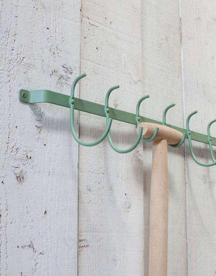 Above; Five pairs of hooks are generously sized to hold handles of rakes, forks, hoes, and shovels.