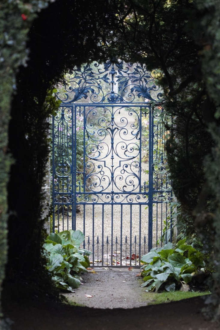 Before a fast-drying black paint was invented in the 30s, iron gates in England were likely to be painted cheerier colors: green, gray, or red.