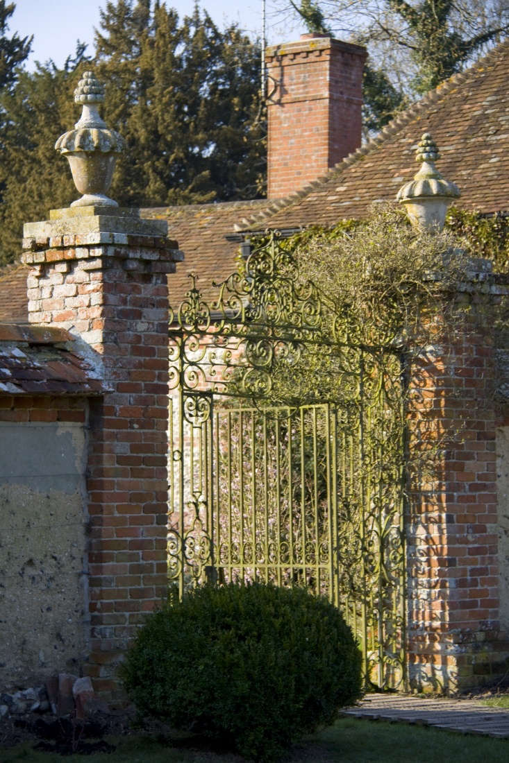 Scrollwork makes even an impregnable gate look friendly.