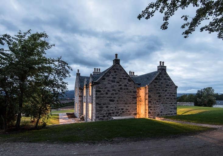 The refurbished farmhouse at night.