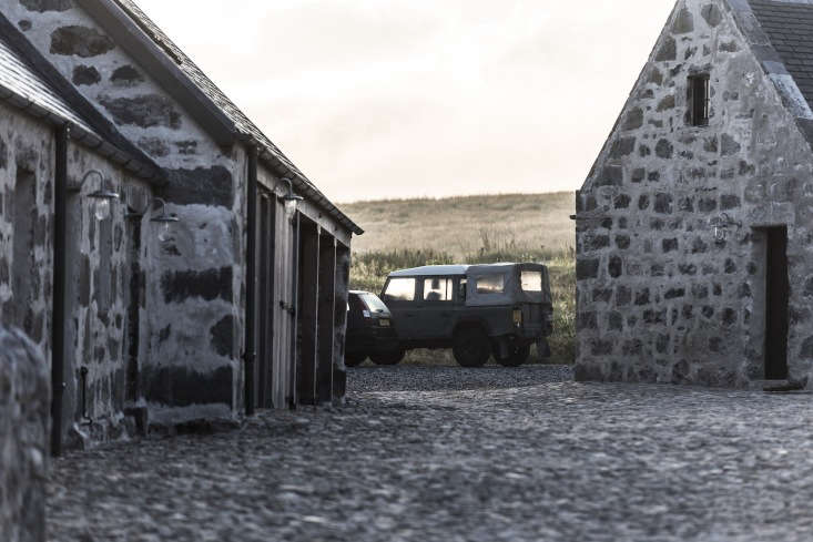 The car stables, located next to the horse stables (now converted into lodgings), house an early-edition Land Rover for guests&#8