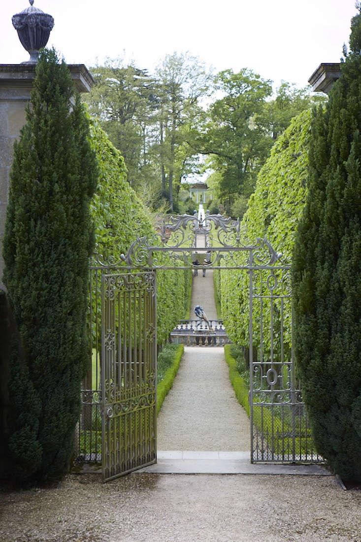 For an opening wider than 4 feet, a double-panel gate reinforces a symmetrical garden design.