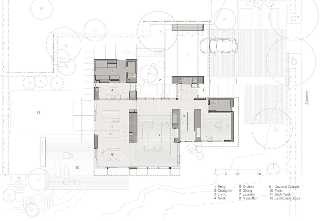 The main-level floor plan shows the driveway and carport, courtyard garden, ipe wood deck, and backyard lawn.