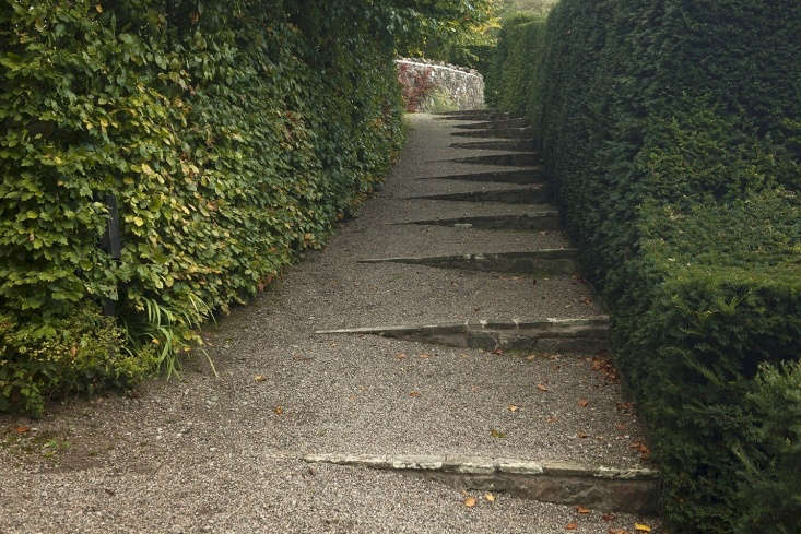 Garden stairs designed by the Archers with beech to the left and yew to the right, enhancing the Voysey atmosphere.
