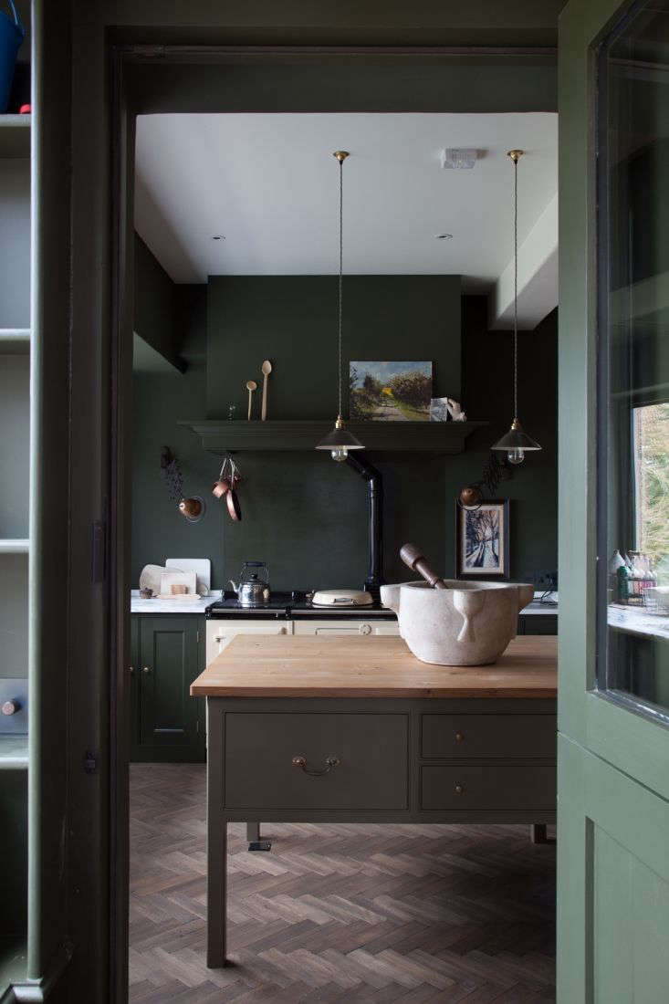 InKitchen of the Week: A Historic Kitchen in Shropshire, a ledge built onto the vent hood provides a stately place for the homeowner to display her artwork.