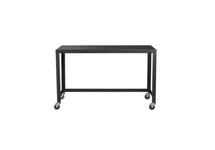 Designed for use in a covered space, CB\2&#8\2\17;s steel Go-Cart Desk on wheels has a carbon powder coat finish and measures 47.75 inches wide; \$\149.