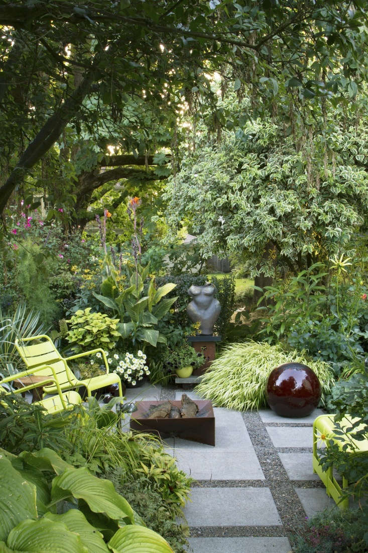 Layering plants creates a sense of depth and distance in a small garden.