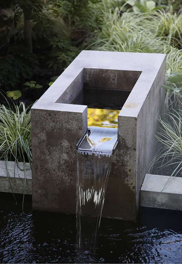 The landscape architects designed an integrated fountain of concrete and bronze for the water feature, &#8