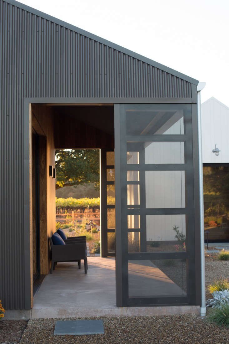 At either end of a patio are sliding screen doors from Sacramento-based Western Windows.