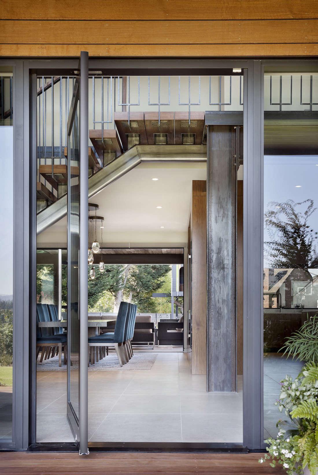 Pivot doors off the house encourage an indoor-outdoor flow.
