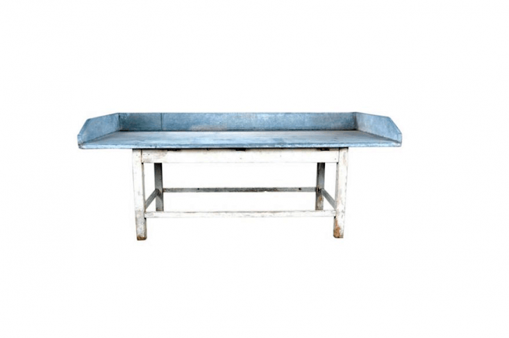 From Belgium, anAntique Zinc Top Potting Bench has a white painted wooden base with stretcher and a work surface that measures 3\2.5 inches; it is \$\2,400 from Mecox.