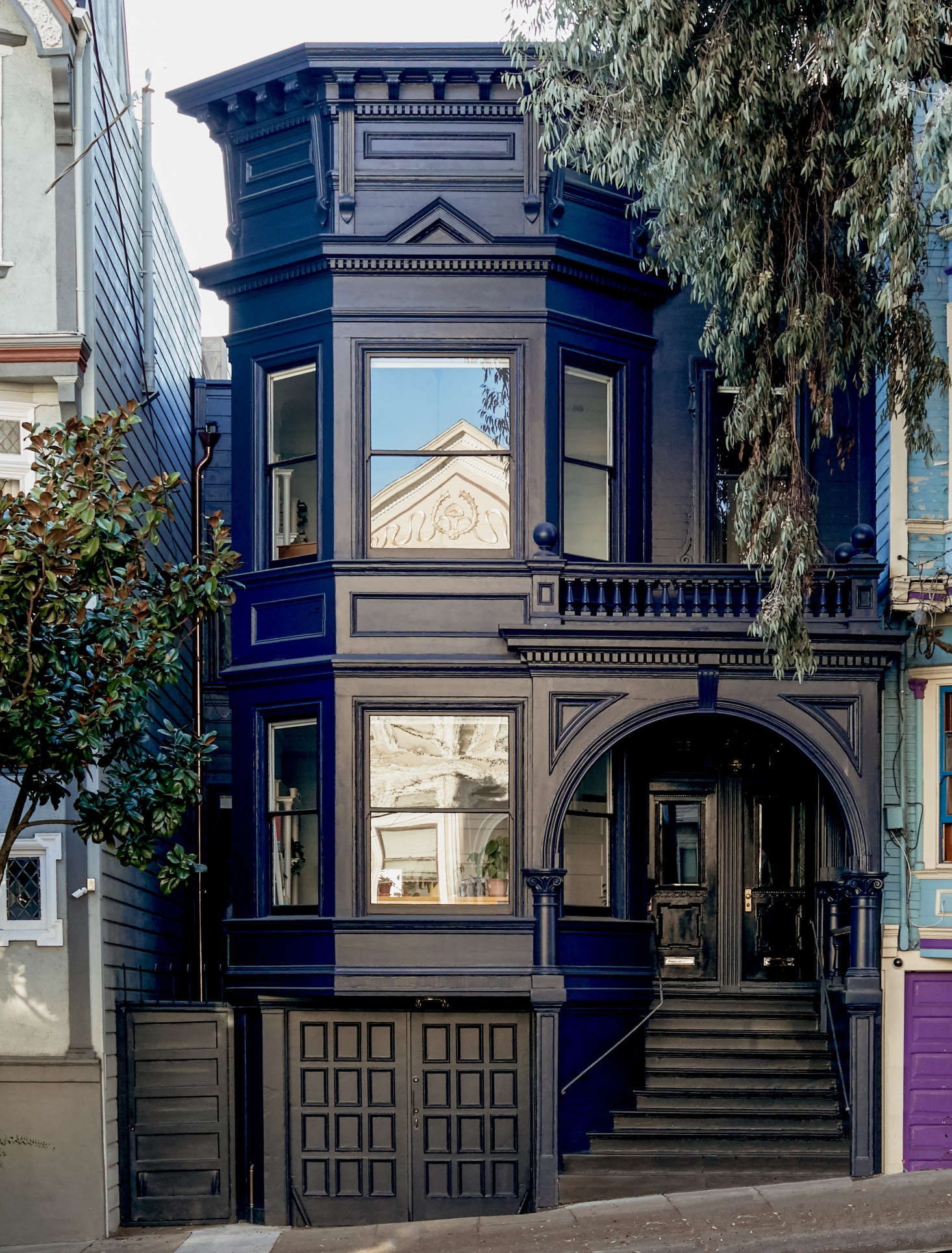 A dark blue facade, accented by glossy black trim and a copper downspout, lends an elegant air to a facade in Before & After: Moody Blues for an Elegant Victorian in San Francisco. Photograph by Daniel Dent.