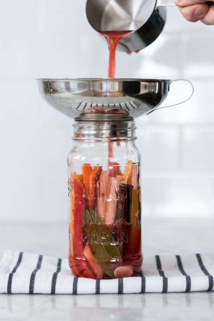 """Use a funnel, some tongs, a slotted spoon, and a measuring cup to transfer the vegetables, spices, and brine,"" Sean says. ""Yes, you could do without one or two of these tools, but they make it a lot easier to fill your jars without any messy kitchen incidents that waste hours' worth of work or leave permanent scars."""