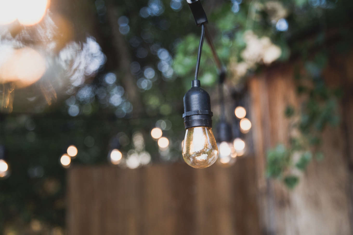 Four strands of Sokani -Foot-Long Outdoor Lights, $.99 each via Amazon, hang from the metal poles.