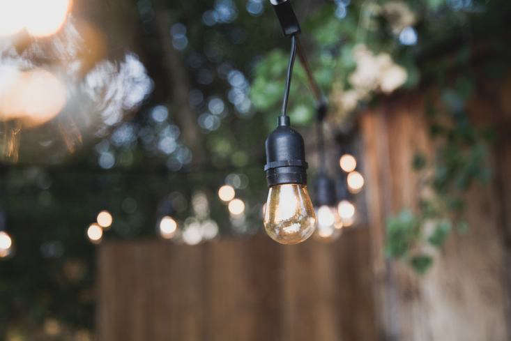 Four strands of Sokani \24-Foot-Long Outdoor Lights, \$3\1.99 each via Amazon, hang from the metal poles.