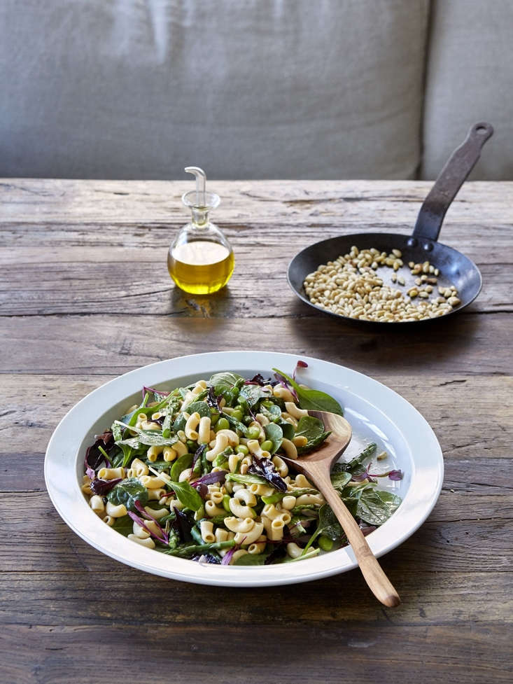 For a quick and delicious lunch, toss veggie pasta with fresh greens—we added a couple of handfuls of baby spinach and some micro greens—a sprinkling of toasted nuts, and a simple dressing of olive oil and lemon.