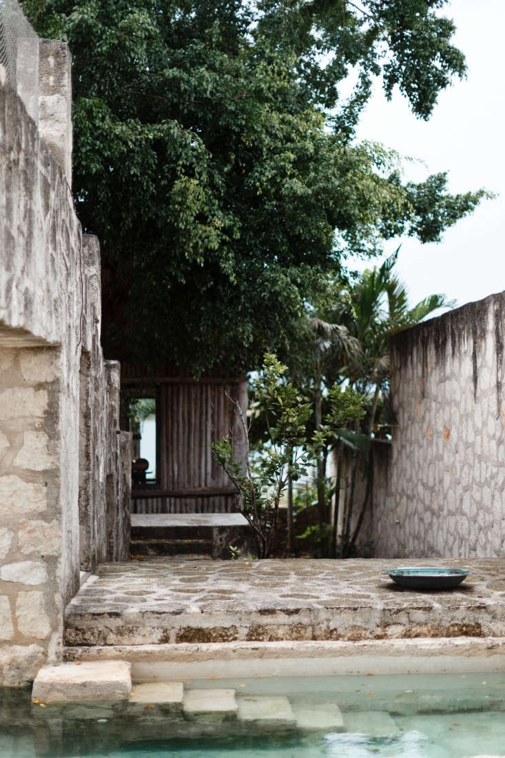 One of two green plunge pools is sheltered by limestone walls and archways, adding privacy—and the distinct feeling that it has been there since Mayan times.