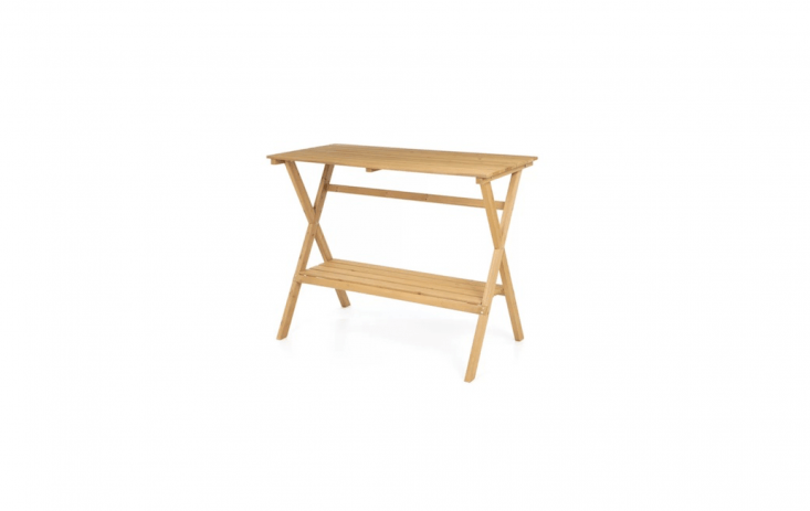A 47-inch-long Corinne Potting Table is a comfortable 37 inches high; made of Chinese fir wood, the worktable has a storage shelf and is $loading=
