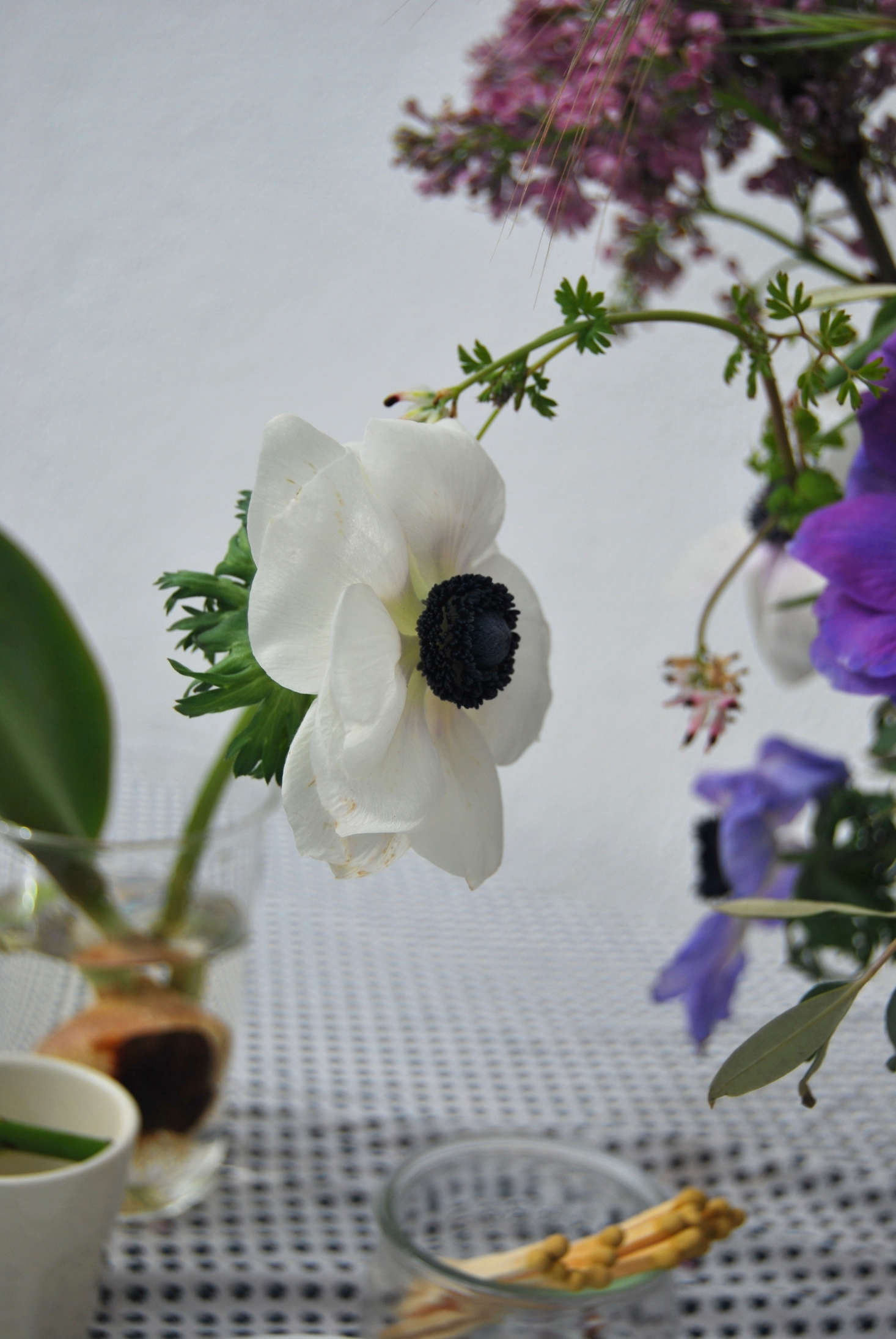 Anemones show their length and work as a focal flower in my Mediterranean-style spring arrangement.