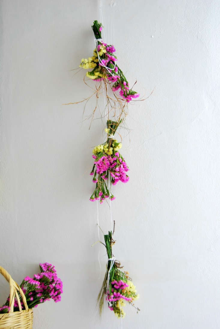 Create a statice installation by hanging small bunches with grasses on a string.