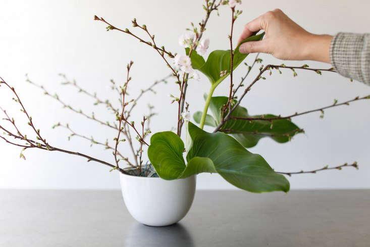 Adding calla lily leaves.&#8