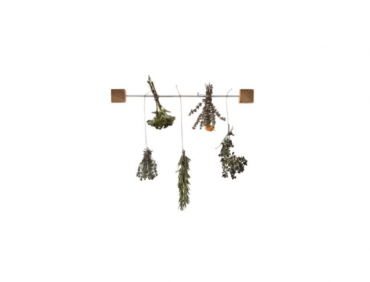 An Herb Drying Rack can be mounted to metal surfaces with its two magnetic wooden cubes; it is $38. from Less and More via Etsy.