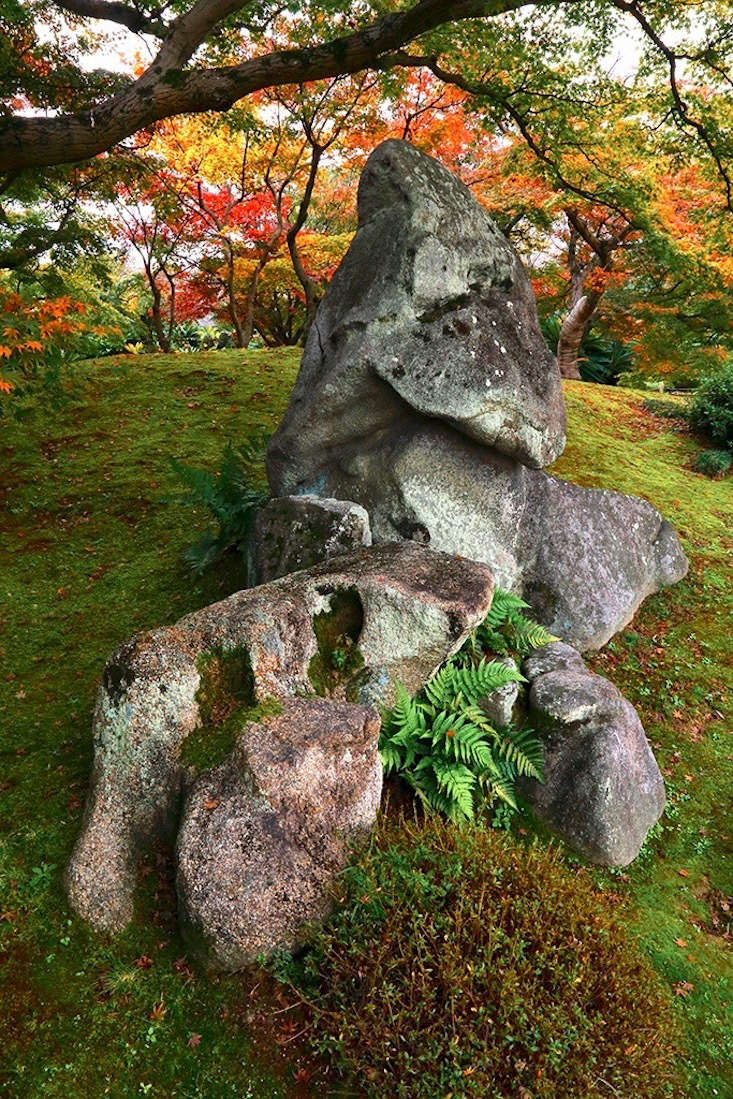 Instead of a sculpture, consider the judicious selection and placement of a beautiful rock. (Yours might be a little smaller than this one.)