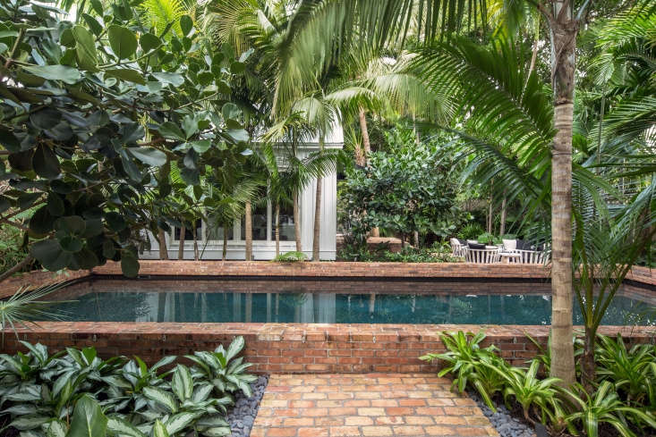 The running bond pattern on the front path continues into the backyard, where brick is used as coping on the raised lip of the lap pool, &#8\2\20;a major renovation of the existing pool,&#8\2\2\1; says Reynolds. &#8\2\20;The coping is so high that it becomes a bench to sit on.&#8\2\2\1;