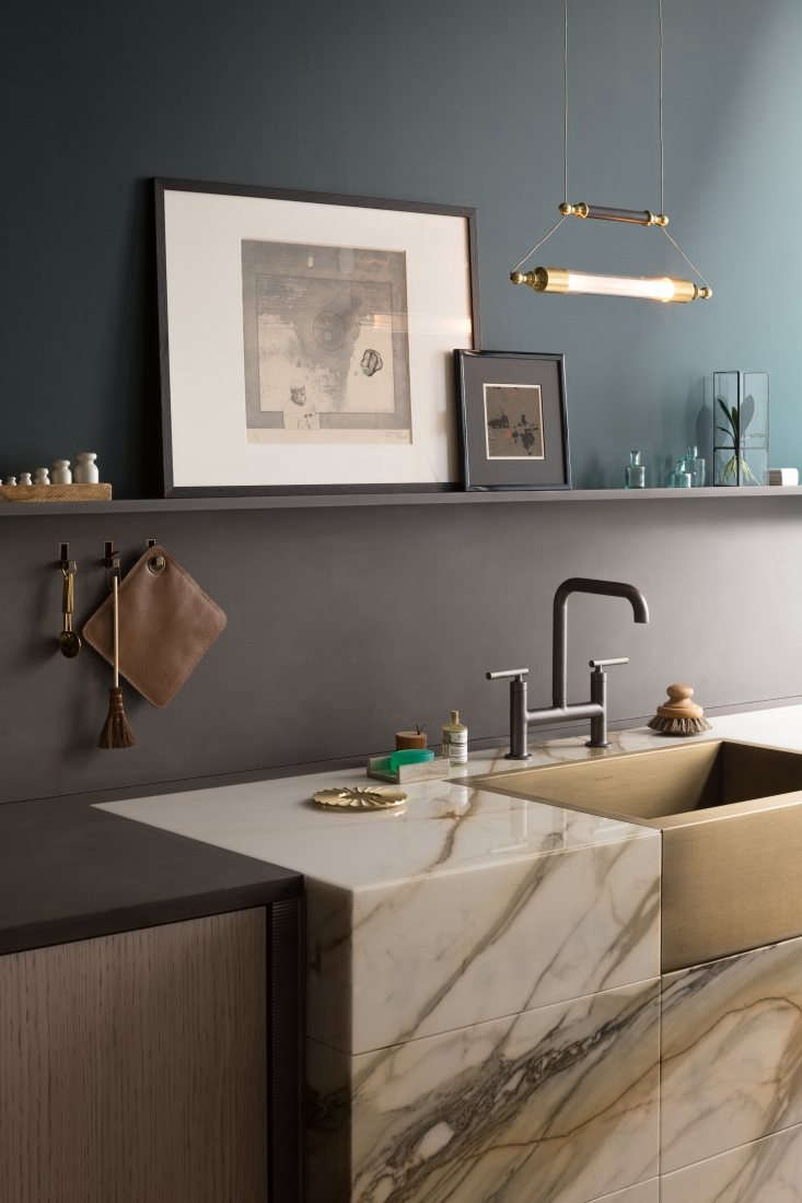 Alexa rounded up her \10 favorite Modern Bridge Faucets, and while the one shown here is stylish, it&#8\2\17;s the clever way this kitchen uses color-blocking—with a shallow ledge delineating the backsplash from the wall, painted in a complementary color—that stopped us. Photograph courtesy of Lanserring, from Kitchen of the Week: A Luxe European Kitchen System, Charcuterie Included.
