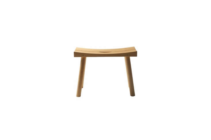 Designed by Finnish designer Kari Virtanen for Nikari, thePeriferia Sauna Stool KVJ3in oiled alderwood is designed with a concave shape and drainage to allow water to drip through the middle.