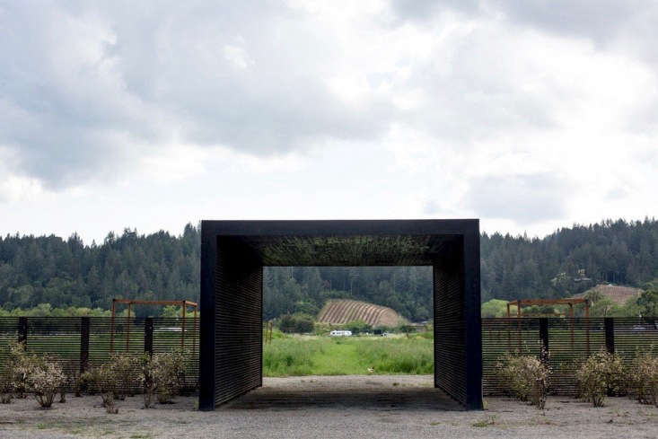 Another black-slatted structure is the farm&#8\2\17;s entryway, framing the view of a bucolic landscape.