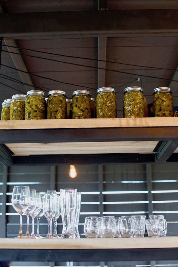 Call it the modern root cellar, with jars of pickled vegetables on display.