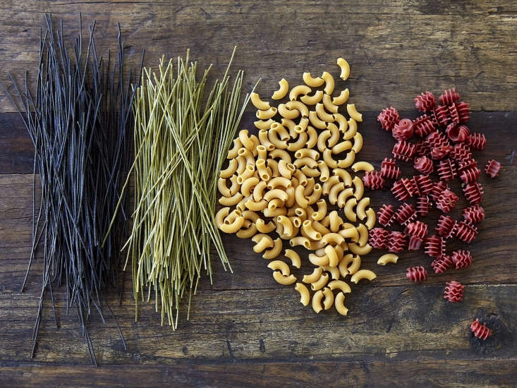 From left, four plant-based pasta substitutes: Explore Cuisine Black Bean Spaghetti, Explore Cuisine Edamame Spaghetti, Banza Chickpea Elbows, and Ancient Harvest Garden Pagoda (Corn, Quinoa, Spinach, Beet, Red Bell Pepper).