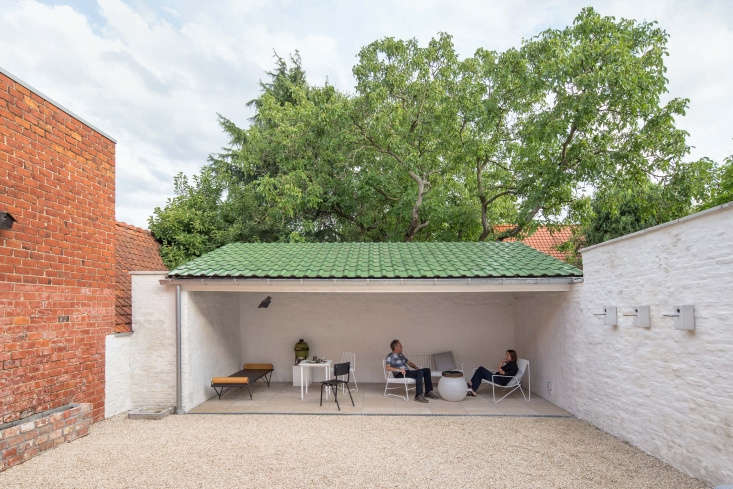 The south-facing courtyard receives full sun. Here, the owners sit on the covered terrace. Photograph courtesy of Danica O. Kus.