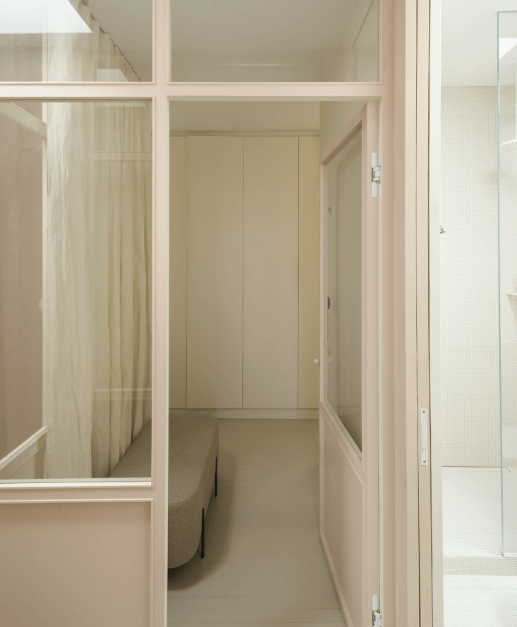 Germany-based interior architects Studio Oink designed a partial glass wall, an architectural detail borrowed from turn-of-century Parisian buildings.
