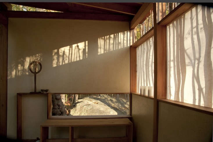 The walls are stained plaster and the rice-paper-like screens are made of a fiberglass paper.